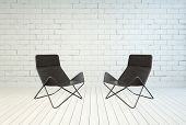 3D Rendering of Two Conceptual Black Folding Lounge Chairs on Empty White Room with White Brick Wall and White Wooden Flooring Design.