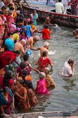 VARANASI, INDIA - MARCH 21: Hindu pilgrims take holy bath in the river ganges on the auspicious Maha Shivaratri festival on March 21, 2013 in Varanasi, Uttar Pradesh, India