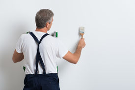 foto of overhauling  - Painter On Stepladder Painting Wall With Brush - JPG