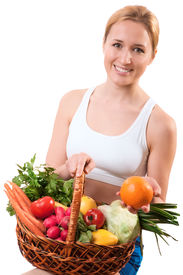 stock photo of healthy eating girl  - young woman holding basket of the vegetables - JPG