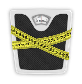 stock photo of measurement  - Measuring tape wrapped around bathroom scales - JPG
