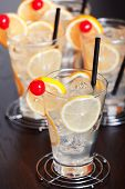 image of collins  - Four Tom Collins cocktails shot on a bar counter - JPG