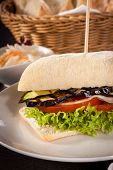 image of veggie burger  - delicious vegan burger with ciabatta bread grilled eggplant and salad - JPG