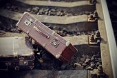 foto of old suitcase  - Two old fashioned suitcases on the railroad tracks - JPG