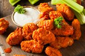 stock photo of chicken wings  - Hot and Spicy Boneless Buffalo Chicken Wings with Ranch - JPG
