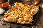 foto of dipping  - Homemade Cheesy Breadsticks with Marinara Sauce for Dipping  - JPG