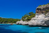 stock photo of cliffs  - Cala Macarelleta beach cliffs at Menorca island - JPG