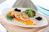picture of patty-cake  - White meat patty cakes with pumpkin mash on restaurant table - JPG