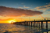 picture of jetties  - Silhouette of fisherman on the jetty at sunset - JPG
