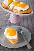 image of yolk  - Fried eggs cookies with peach yolks on a white plate - JPG
