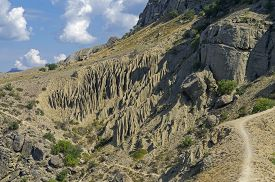 pic of denude  - The results of weathering and leaching of rocks on the hillside - JPG