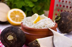 stock photo of grated radish  - Grated black radish salad in rustic bowl - JPG