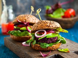 stock photo of veggie burger  - Veggie beet and quinoa burger with avocado - JPG