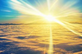 stock photo of cloudy  - Amazing view from plane on the sky sunset sun and clouds - JPG