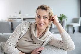 stock photo of maturity  - Portrait of mature smiling blond woman  - JPG