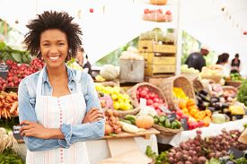 picture of stall  - Female Stall Holder At Farmers Fresh Food Market - JPG