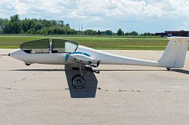 picture of glider  - glider or sailplane on runway with canopy open at municipal airport in faribault minnesota - JPG