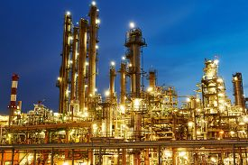 foto of refinery  - Oil refinery plant of petroleum or petrochemical industry production at sunset - JPG