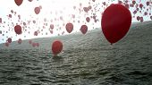 red balloons over the ocean