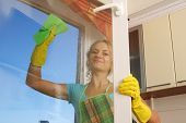 stock photo of house cleaning  - Women cleaning a window 2 - JPG
