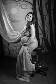 Portrait Of A Pregnant Woman On Black And White