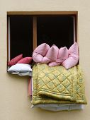 Window with pillows and blanket