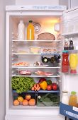 pic of refrigerator  - refrigerator full with some kinds of food  - JPG