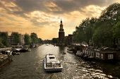 View on city canal (Amstel river) with cruise ship in Amsterdam.