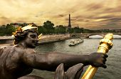 View on Seine River and Eiffel Tower from Alexander III bridge (pont Alexandre III) in Paris, France
