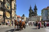 PRAGUE - JULY 17 : Tourist carriage passes by Old Town Square (Stare Mesto) in front of Tyn Church a