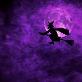 picture of she devil  - grunge background with silhouette of witch flying on a broom on full moon halloween night - JPG