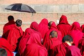 Buddhist monks praying at swayambhunath temple in Kathmandu, Nepal