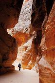 Tourist walking in Siq of world wonder Petra in Jordan