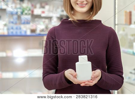 Unrecognizable Young Woman Standing In