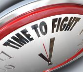 stock photo of won  - A clock with the words Time to Fight illustrating the urgency of standing up for your rights and demonstrating to those in power that you won - JPG
