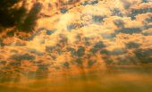 God Light. Dramatic Dark Cloudy Sky With Sun Beam. Yellow Sun Rays Through Dark And White Clouds. Go poster