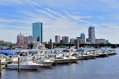 stock photo of prudential center  - Boston Charles River with urban city skyline skyscrapers and boats with blue skyr - JPG