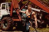 Power Concept. Power Man Pull Tractor With Crane. Power Lifter At Construction Site. Feel The Power. poster
