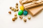 Easter Holiday Concept. Easter Gifts In Craft Paper, Quail And Chicken Eggs And Pussy-willow Branche poster