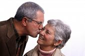 stock photo of social-security  - mature couple kissing over white background - JPG
