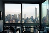 View Of Skyscrapers Of  New York City (manhattan) Through Windows Of Apartment. Top View Of Midtown  poster
