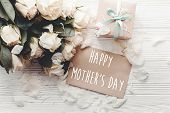 Happy Mothers Day Text Sign On Craft Greeting Card And White Roses Bouquet, Gift Box On Wooden Back poster