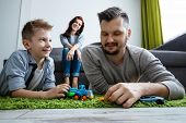 Dad And Son Are Playing Toy Cars. The Concept Of Family Enthusiasm, Time With Family, Copy Space. poster