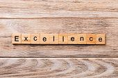Excellence Word Written On Wood Block. Excellence Text On Wooden Table For Your Desing, Concept poster