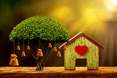 House Model And Red Heart For Family And Big Money Bag Of Tree As Destinations Is Saving Put On The  poster