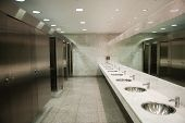 stock photo of gents  - Public empty restroom with washstands mirror - JPG