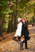 Two beautiful girls in autumn outdoors