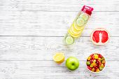Diet Rich In Fruits. Slimming Diet. Fruit Salad Near Fruit Lemon And Cucumber Water On White Wooden  poster