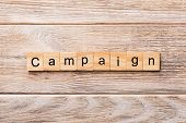 Campaign Word Written On Wood Block. Campaign Text On Wooden Table For Your Desing, Concept poster