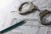 Tax Evasion And Avoidance Concept. Annual Income Declaration Form And Handcuffs poster
